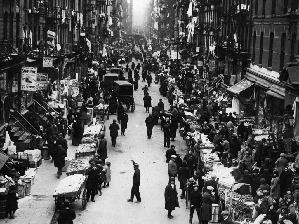 The pushcart market in the East Side Ghetto of New York's Jewish Quarter was a hive of activity in the early 1900s.  Source: Ewing Galloway/Getty Images & NPR